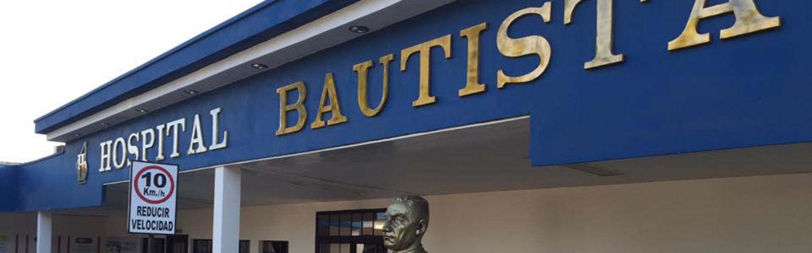 blue hospital building with brass lettering Hospital Batista
