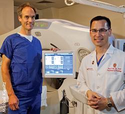 Van Der Weide and Lee standing with the equipment